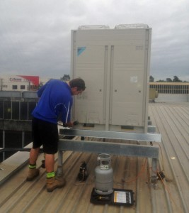 Air & WAter installing 25kW Daikin ducted reverse cycle aircon outdoor unit